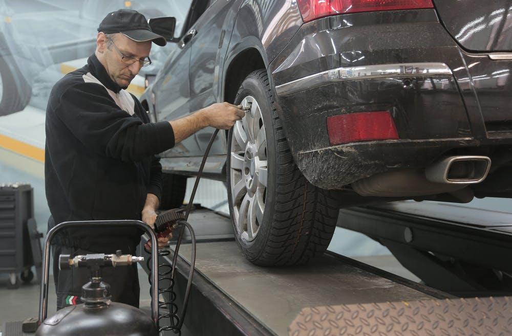 Worker using automotive workshop equipment